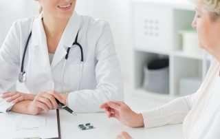 Elderly woman speaking with pharmacist