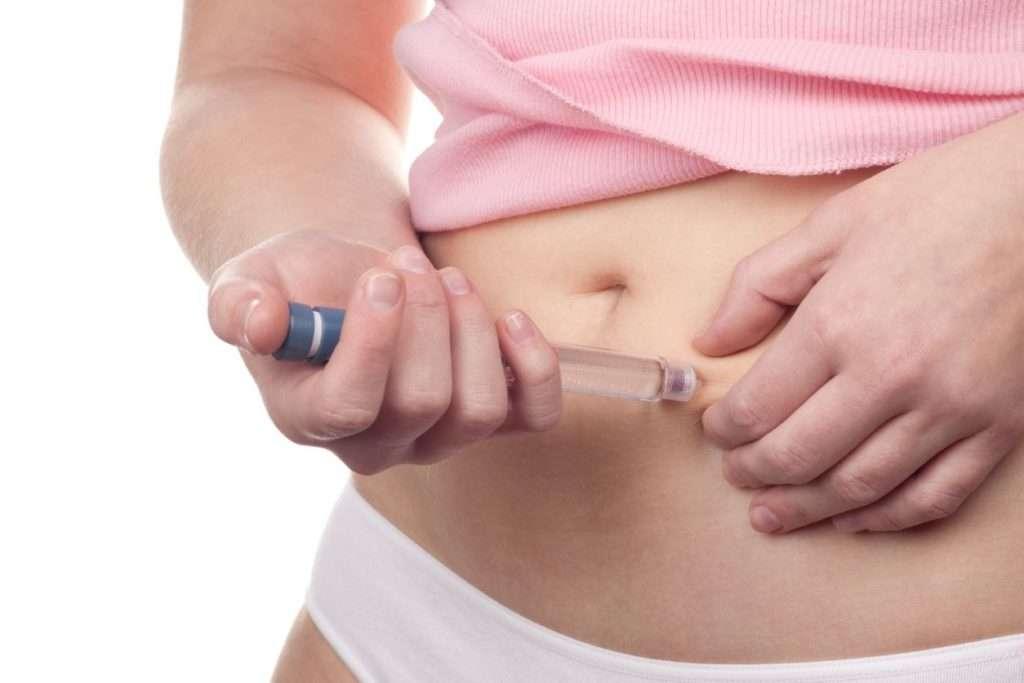 Woman Injecting Saxenda Pen into Abdomen