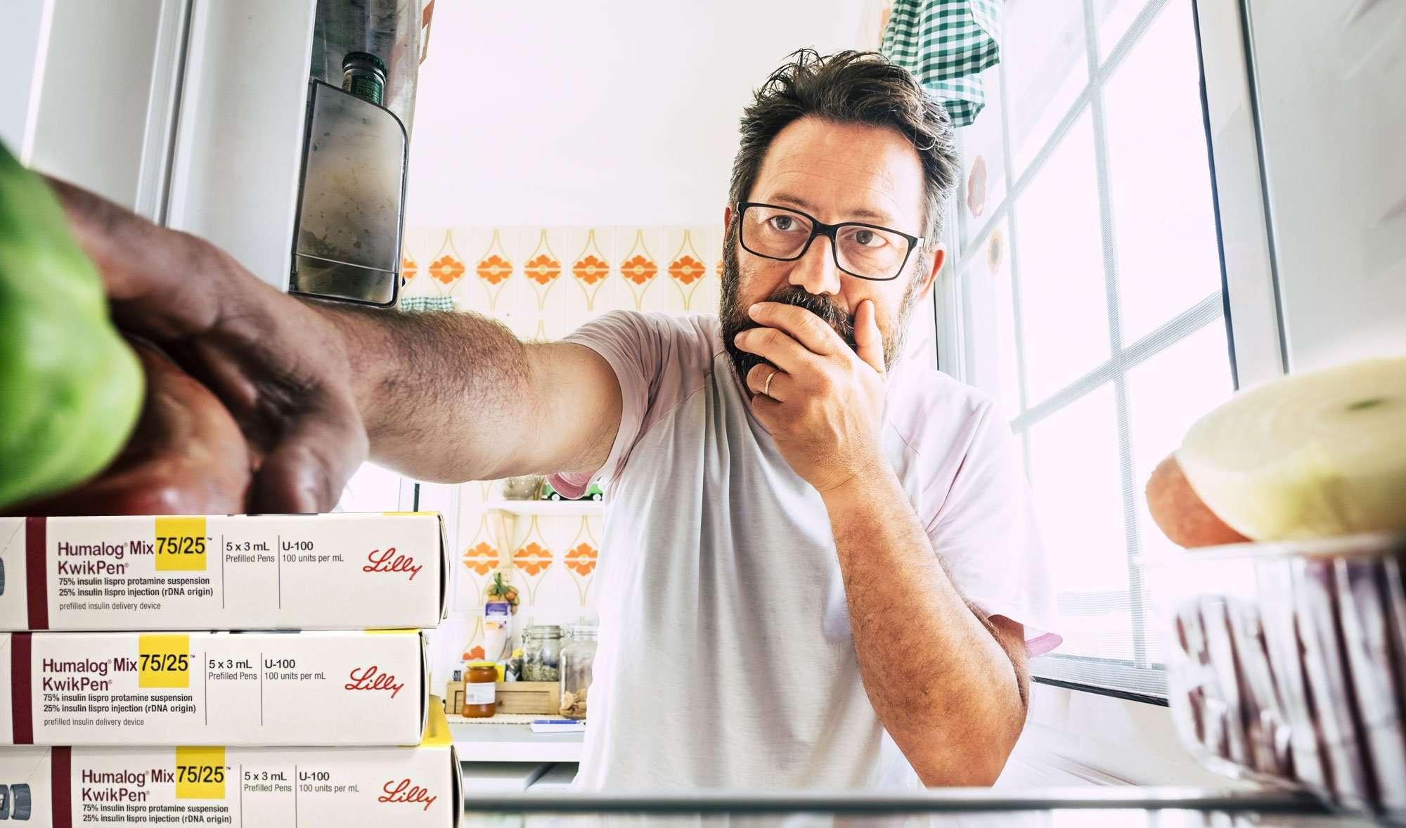 Man reaching for apple in fridge